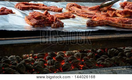 Barbequing Ribs On Charcoal Fire
