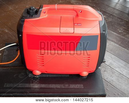 red mobile gasoline generator for the house