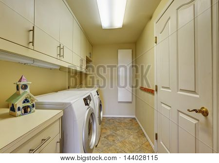 Light Beige Laundry Room With Cabinets And Tile Floor