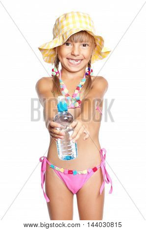 Happy little girl in swimsuit with bottle of water. Laughing child in hat, isolated on white background.