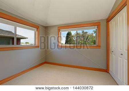 Grey Interior Of Empty Room With Two Windows.