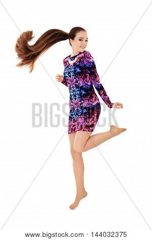 girl with very long hair jumps. The concept of beauty and fashion