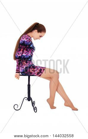 woman with very long beautiful hair sitting on a chair