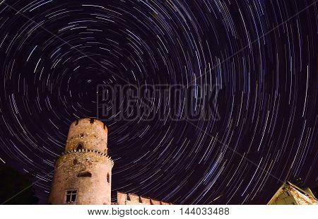 star trail in the night sky at midnight dark