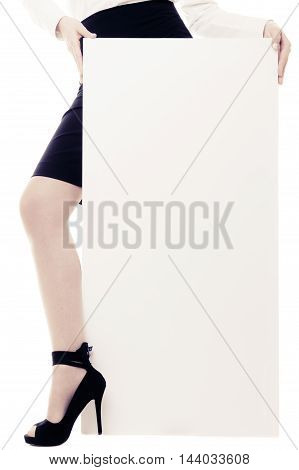 Advertisement. Blank copy space banner and sexy female leg isolated on white. Businesswoman recommending your product