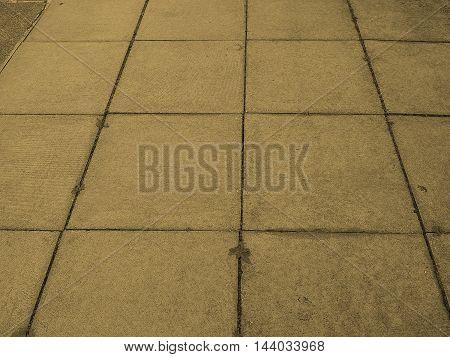 Grey concrete pavement tiles useful as a background vintage sepia