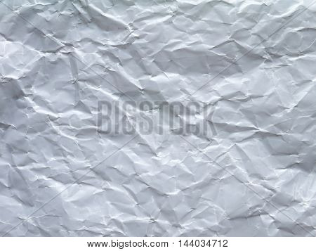 White crumpled wax paper sheet closeup background