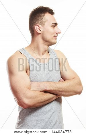 Handsome muscled sporty fit man. Portrait of young muscular guy isolated on white. Healthy lifestyle.