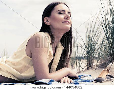 Woman Resting On Beach.