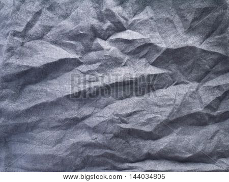 Crinkled dark gray natural linen fabric texture