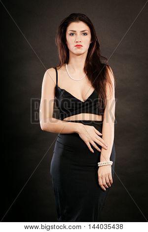 Woman In Sensual Black Dress On Dark