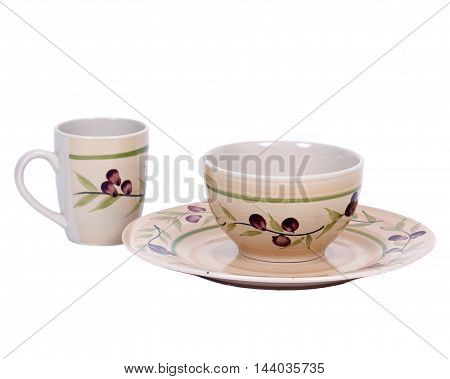 Painted cup, bowl and plate separated on white background