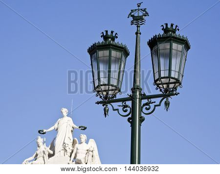 Bronze street lamp decorating the Commerce Square in Lisbon Portugal