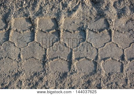 Background made of tyre tracks on the sand