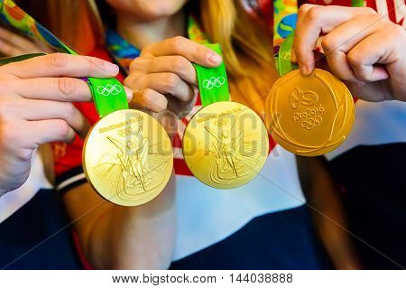MOSCOW, RUSSIA - AUGUST 24, 2016: Meeting with the russian women handball team.Gold medals of Olympic Games in Rio demonstration