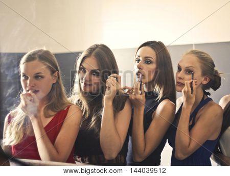 Girls putting make up on
