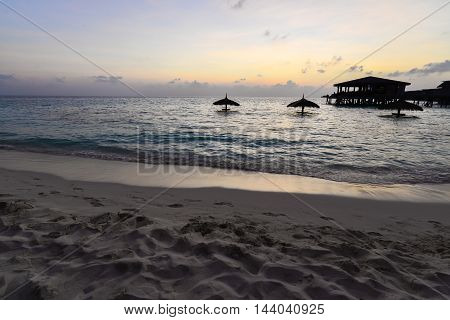 Sunset from the beach with Dark Bungalow view Maldives