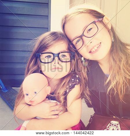 Two sweet little girls together with glasses - Instagram filter