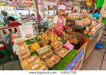BANGKOK THAILAND - AUGUST 4: Unidentified female cook variety food at Yaowarat Road in Bangkok's Chinatown district on August 4 2013 in Bangkok Thailand