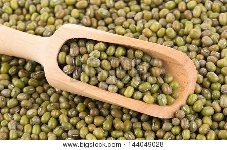 Pile of mung beans in the wood spoon