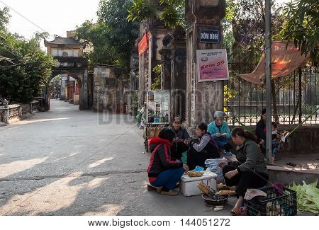 HA NOI, VIET NAM, August 23, 2016. morning. group of people Ha Noi, trading fruit and vegetables, the ancient temple on the outskirts of Ha Noi