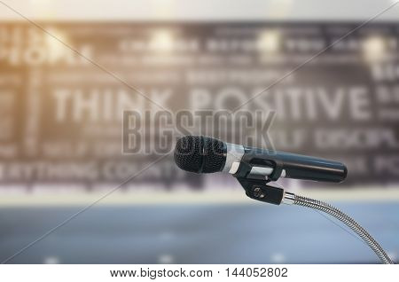 microphone in hall with lights in background. with extremely shallow dof.