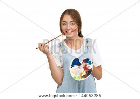 young beautiful woman painter holding a brush and palette