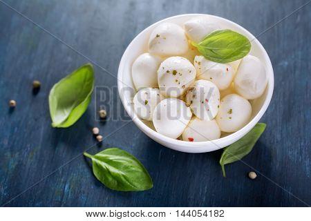 Mozzarella balls and fresh basil, selective focus