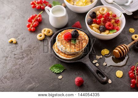 Healthy Breakfast with berries and pancakes. Food background