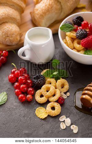 Healthy breakfast with berries corn rings. Food background