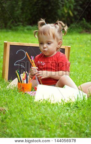school. little girl playing in the school. early childhood development