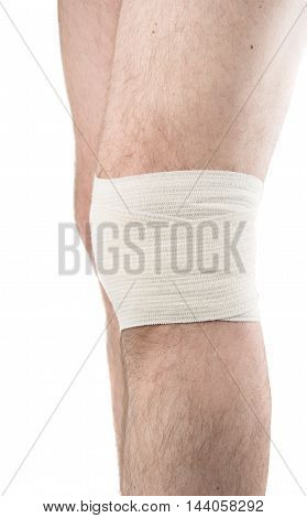 man with elastic bandage on knee isolated on white