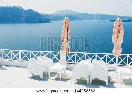 White architecture on Santorini island Greece. Beautiful terrace with sea view