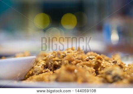 Thai fried chicken tendon food with bokeh background