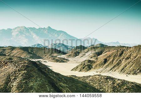 Mountains In The Arabian Desert At Sunset