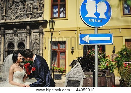 Wedding Couple On Streets Of Old City Kissing On Kiss Place Plate