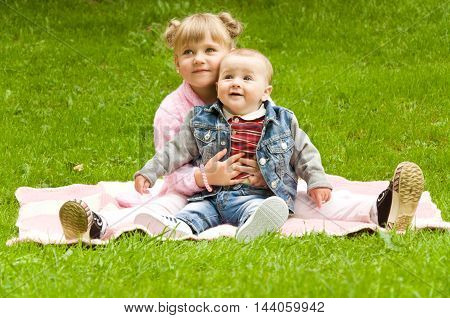 little girl playing with her favorite brother outdoors