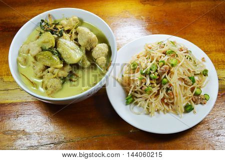 green curry fish ball with eggplant eat couple with spicy rice noodle