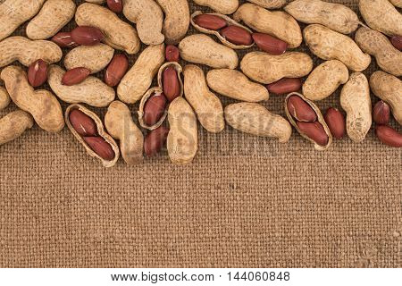 Peeled peanut on well peanuts. Top view.