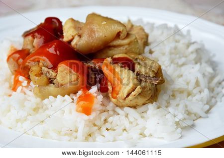 fried salty chicken dressing tomato and chili sauce on plain rice