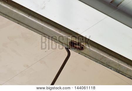 long iron hook pull the door shutter down