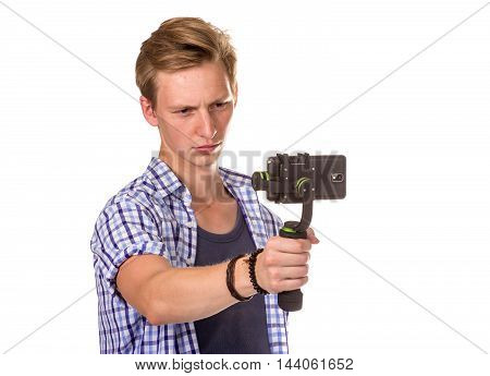 Man Holds Small Action Camera.