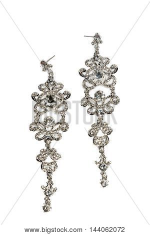 Pair of diamond earrings on white background