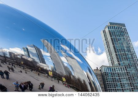 CHICAGO - MARCH 17: Cloud Gate in Park on March 17 2016 in Chicago. The Cloud Gate (bean) is a major tourist attraction in Chicago