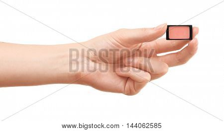 Female hand holding eye shadow, isolated on white