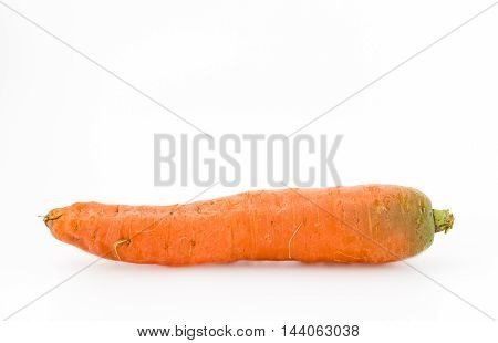 Genuine carrot from organic farming isolated on white background.