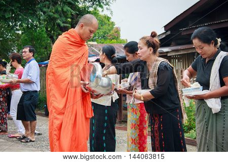 Sangkla Buri Kanchanaburi THAILAND - OCT 26 : Buddhist monks are given food offering from people for End of Buddhist Lent Day. on October 26 2013 in Sangkla BuriKanchanaburiT hailand.