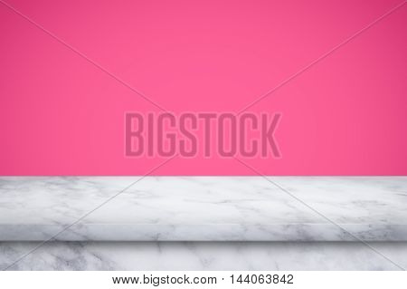 Empty white marble table on pink gradient wall background. For display or montage your products.