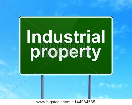 Law concept: Industrial Property on green road highway sign, clear blue sky background, 3D rendering