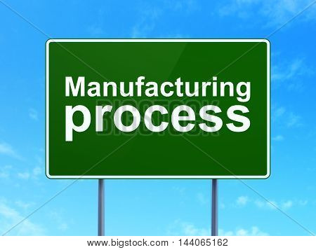 Manufacuring concept: Manufacturing Process on green road highway sign, clear blue sky background, 3D rendering